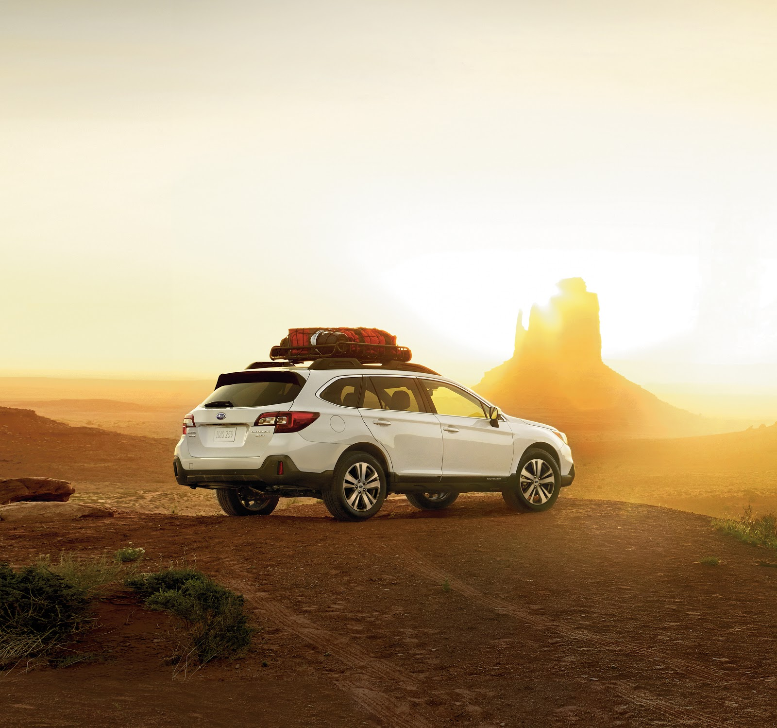white subaru outback parked in the desert