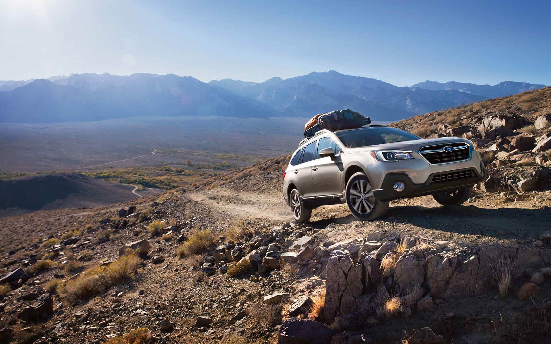 silver 2019 subaru outback driving up a mountain