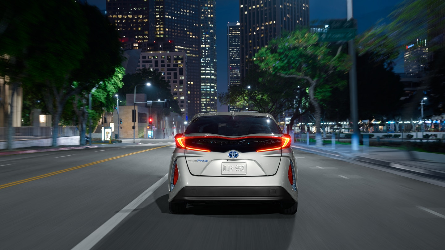 Silver 2019 Toyota Prius Prime driving at night