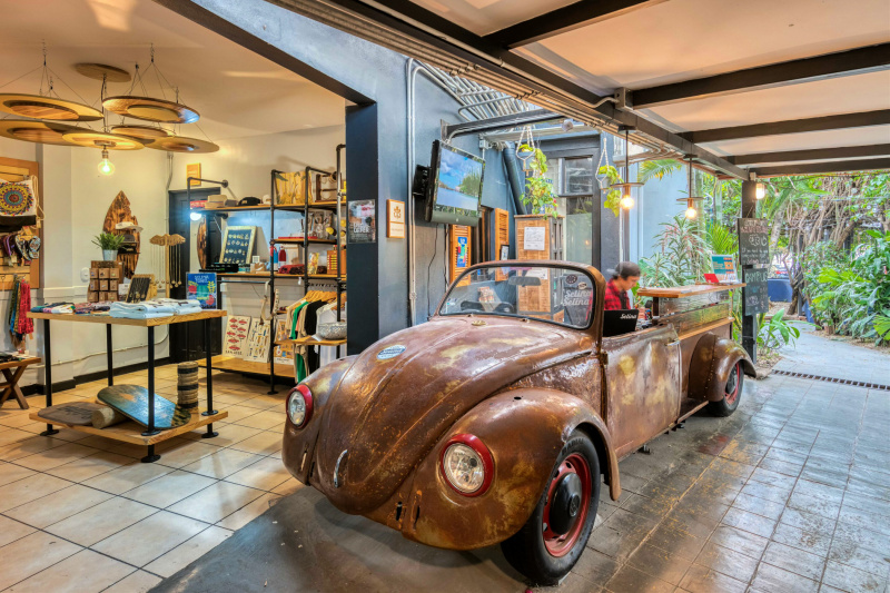 A refurbished car functions as the hotel's front desk and is positioned at a standing height.