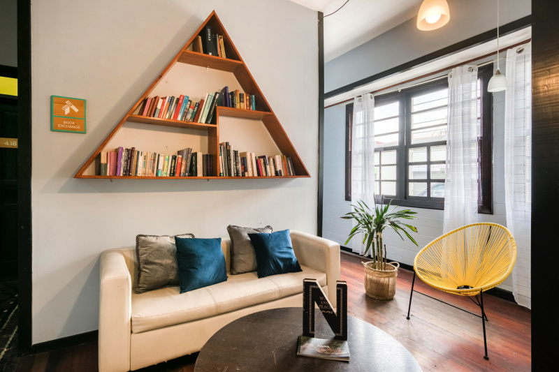 Library with trendy book shelves and comfortable lounge seating.