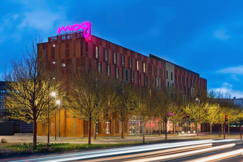 Moxy hotel exterior with bright pink neon sign