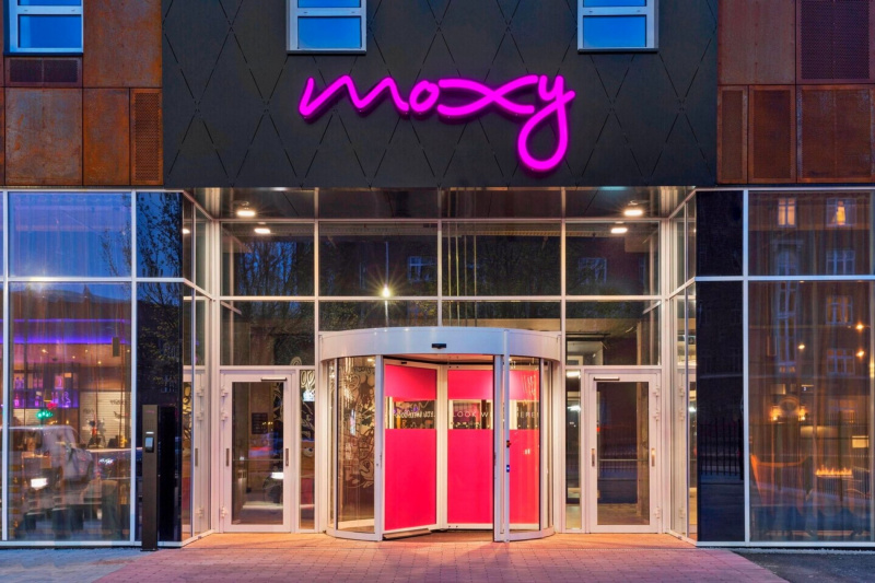 Moxy hotel entrance with step free doorwarys and rotating door