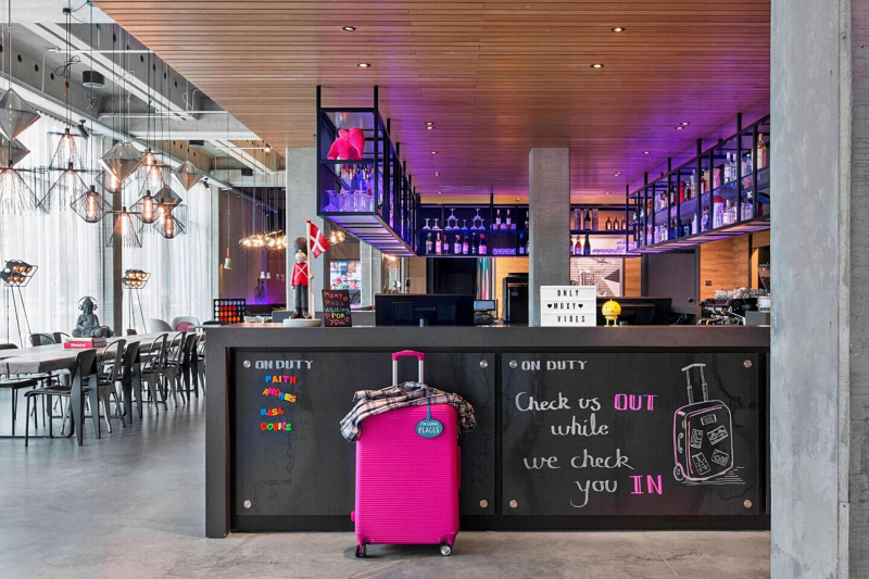 Trendy lobby entrance and bar with purple stage lights