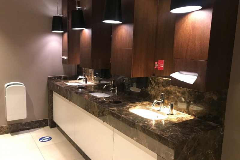 Shared restroom with three sink stations