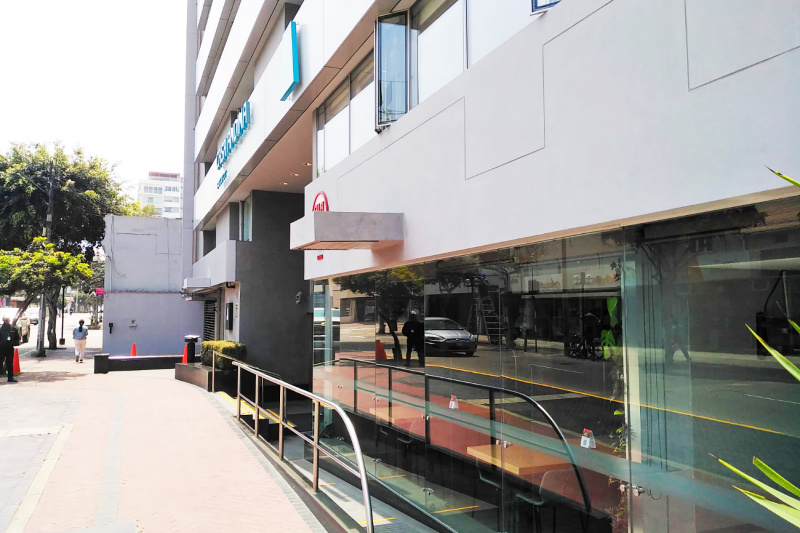 Hotel is shown with an accessible ramp to reach the lobby entrance.