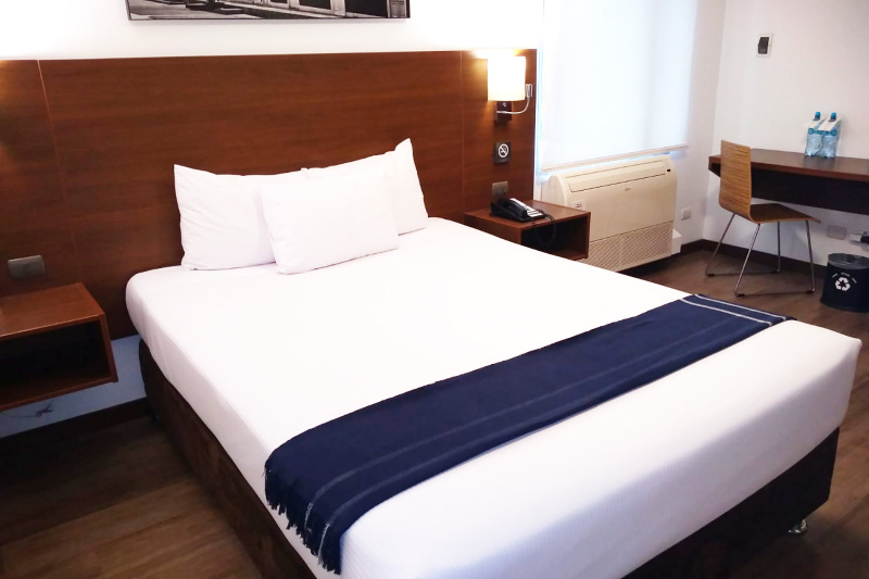 Bed is shown to have reachable temperature controls.