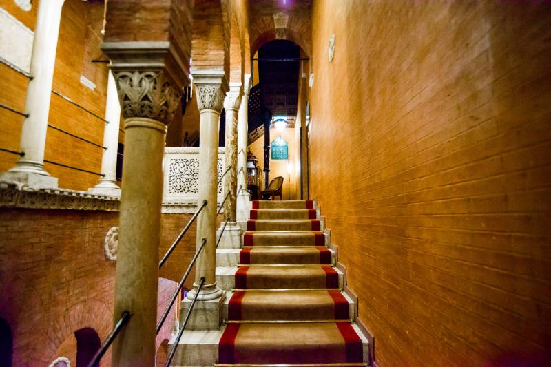 Ornate carpeted stairway