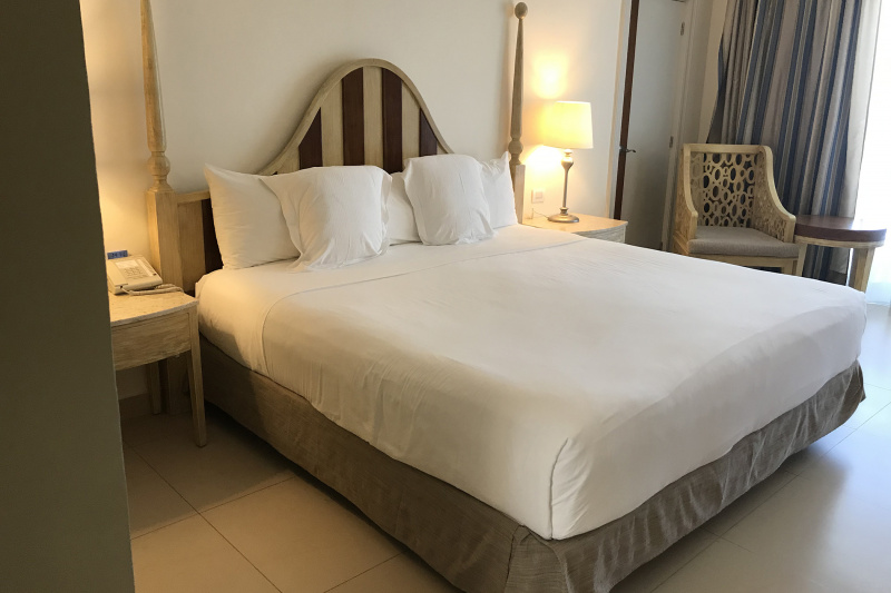 King bed with bedside tables and refined decor.