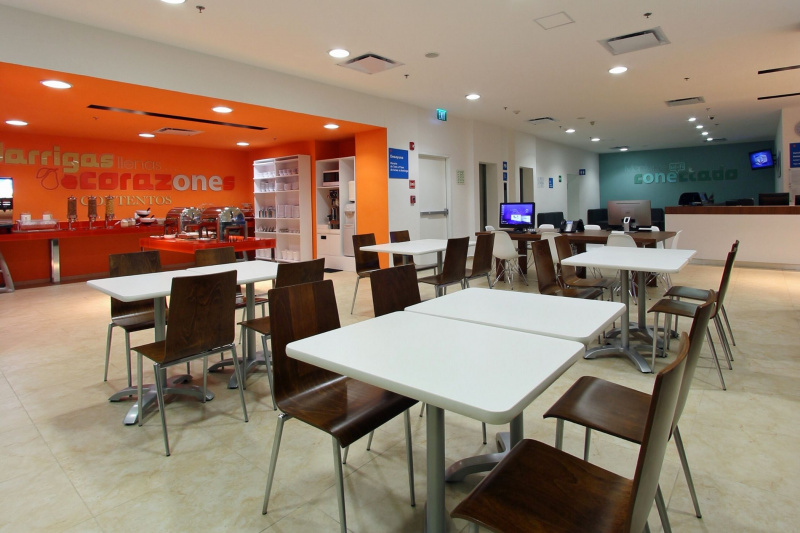 Dining area with tables at an accessible height and buffet area