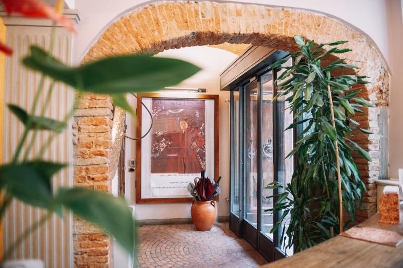 Indoor brick archway and plants