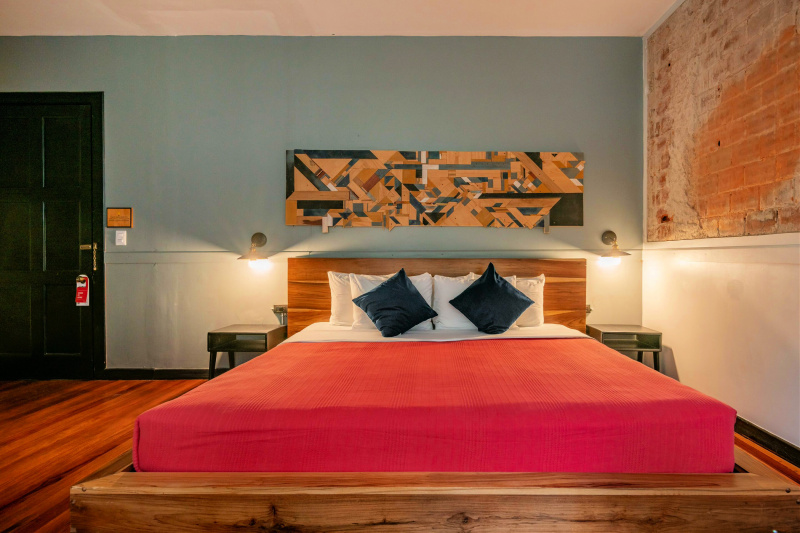Suite with modern artistic décor and a comfortable king sized bed.