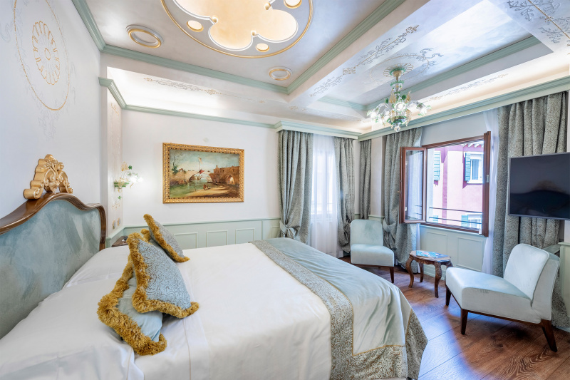 Golden Leaf Superior Room with spacious bedside pathways and city views