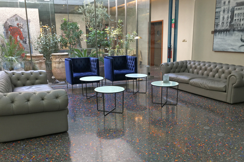 Lobby lounge area with comfortable seating and coffee tables at a reduced height