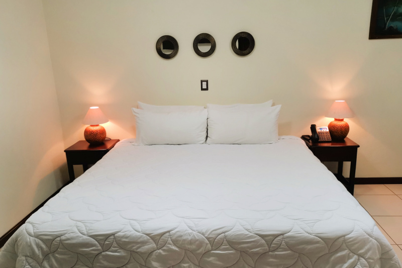 Bromelia room features a king bed with tile floors and turning space over 152 cm.