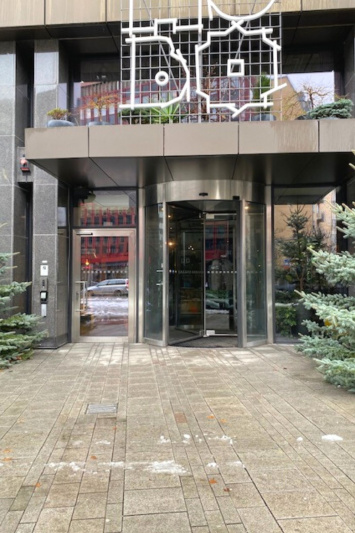 HOBO Hotel entrance has a revolving door and stone tiled entrance.