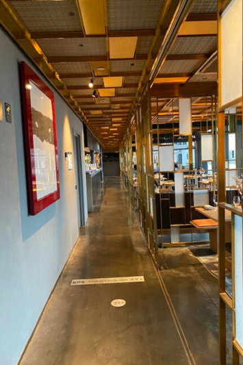 Access to breakfast area at HOBO Hotel has smooth flooring and modern decor.