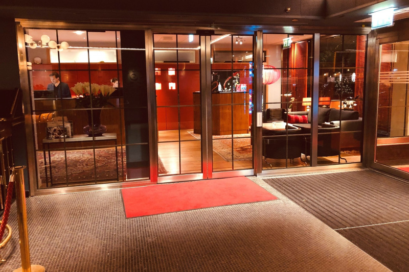 Hotel Rival Lobby a modern red monochromatic interior design, a check-in desk, and a variety of seating options