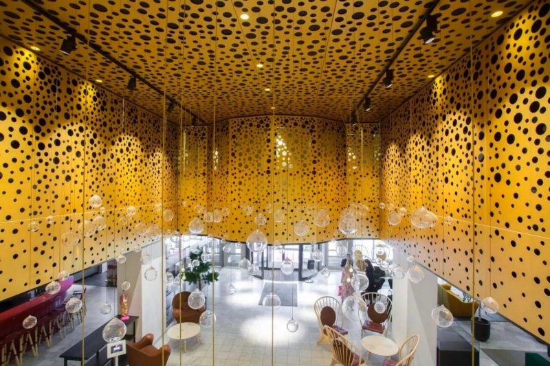 Hotel lobby with bubble like decor and chandelier.
