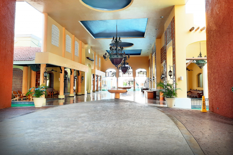 Spacious lobby and entry area with spanish theme, ramps, and seating areas