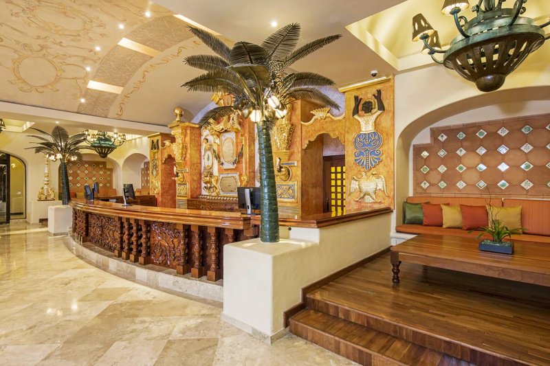 Detailed front desk made from wood and mediterranean theme