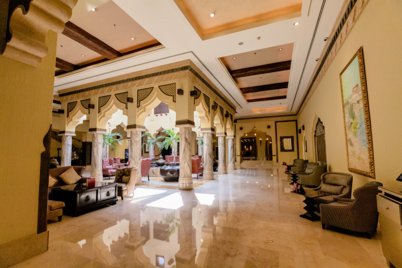Sharq Village & Spa lobby with opulant marble furnishings and columns and smooth marble floors