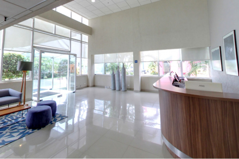 Hotel lobby with smooth floored, step free lobby with standing height front desk.