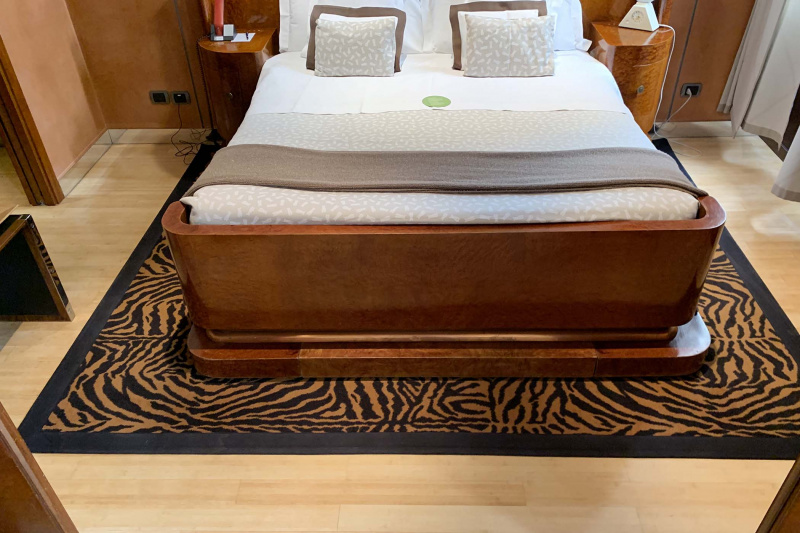 Accessible room queen bed with bedside tables and spacious walkways