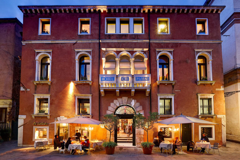 Ca'pisani Hotel with exterior with cobblestone patio and outdoor seating