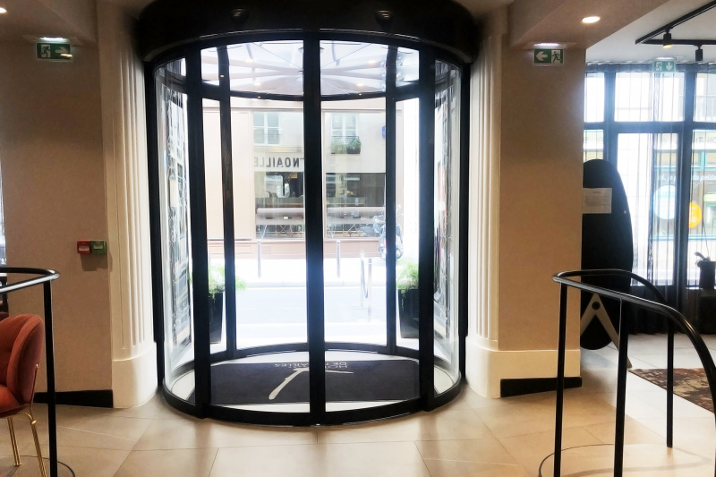 Circular lobby entrance with accessible, wide double doors