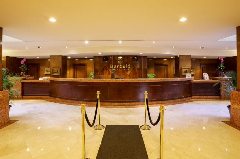 Spacious Barceló lobby has smooth tiled flooring and a wide check-in table