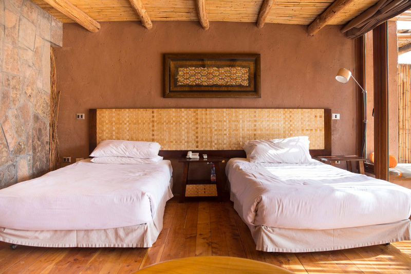Two twin beds with a space between them.