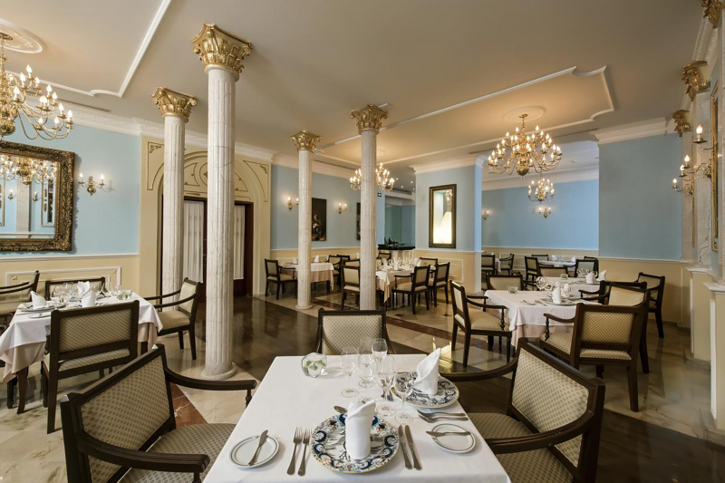 El Colonial Gourmet Restaurant dining space with classical French decor