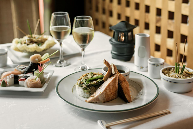 Glasses of white wine with assorted international foods at La Plaza Buffet