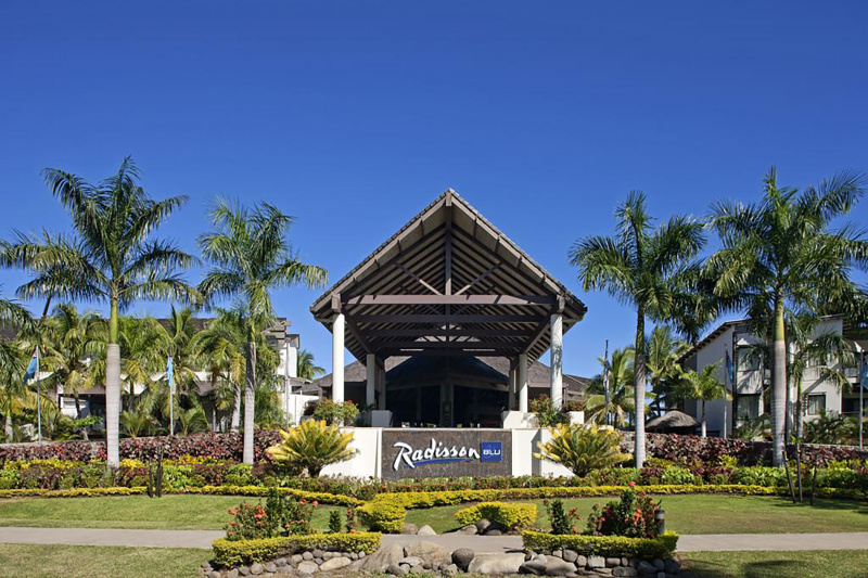 Radisson Blue Resort with ocean views and tropical foliage