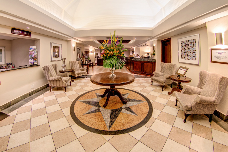 City Lodge Hotel exterior lobby with standing height front desk, smooth floors, and free turn space