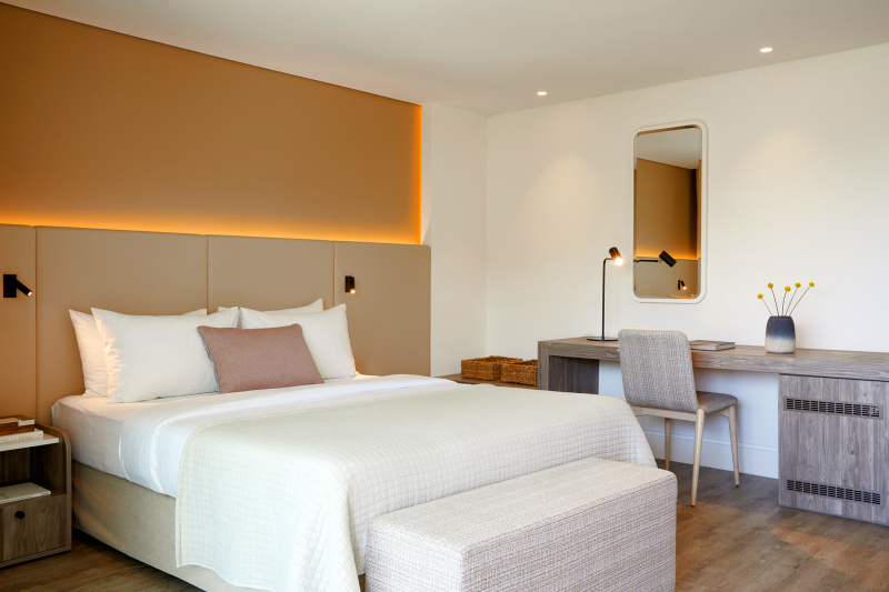 Accessible deluxe superior room with work desk and bed.
