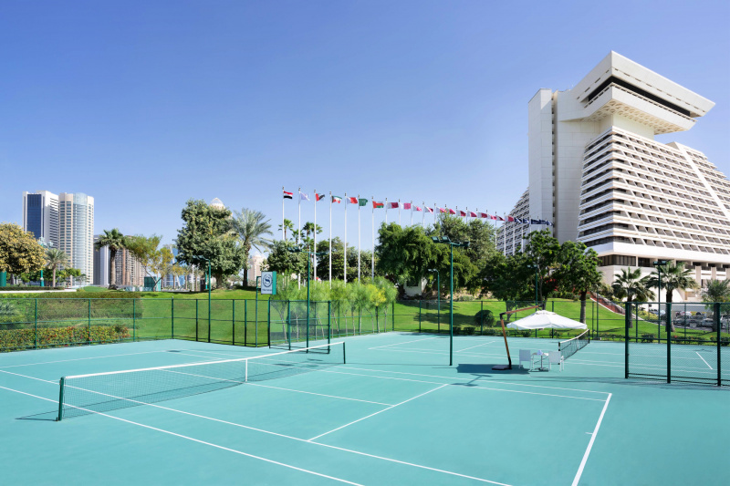 Hotel tennis courts and rolling green hills