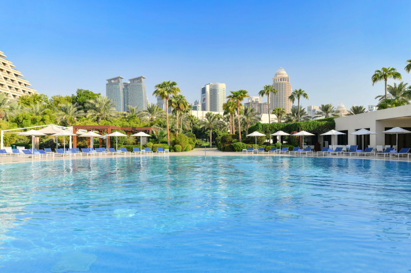 Swimming pool with city views and luxurious poolside seating
