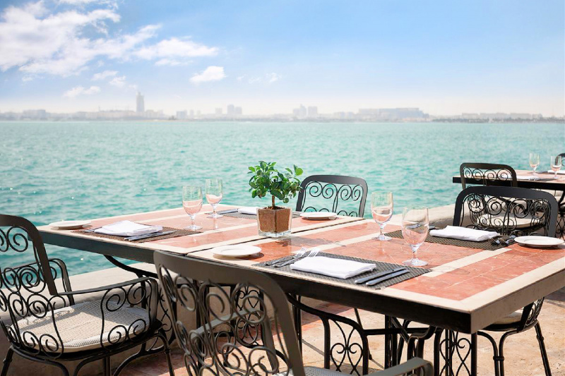 Outdoor terrace with oceanside seating
