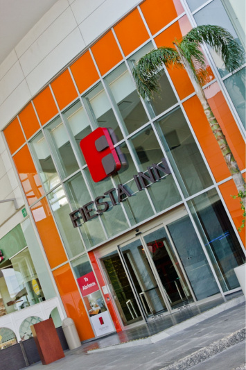 Fiesta Inn entrance with steps and a ramp.