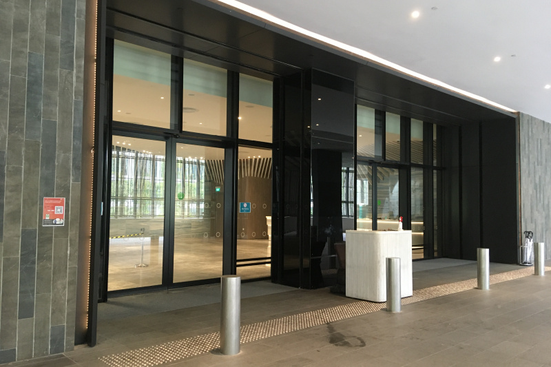 the hotel entrance is shown to be accessible through its features like wide sliding double doors.