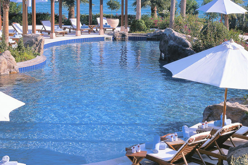 Outdoor pool ocean views and lounge seating