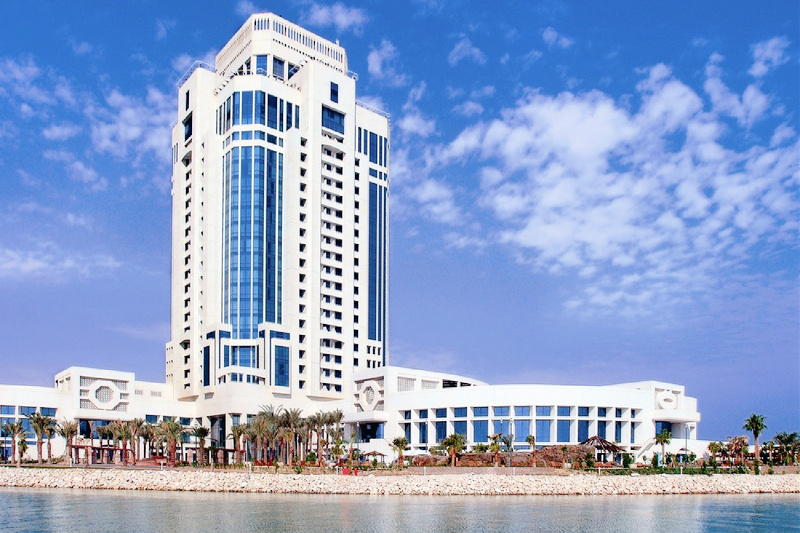 The Ritz-Carlton, Doha exterior with views of a crystal clear blue sky
