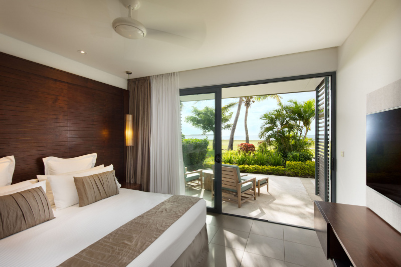 Bedroom with king bed and step-free patio with ocean views