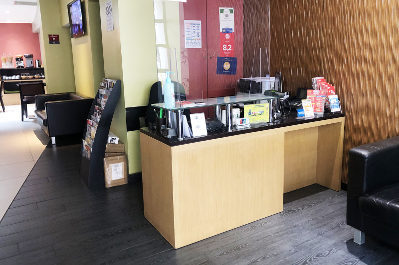 Front desk positioned at accessible height with covid-safe screen
