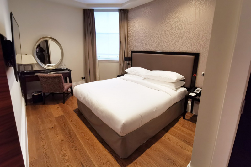 The suite is spacious and features an accessible work desk, large window, and wide pathways.