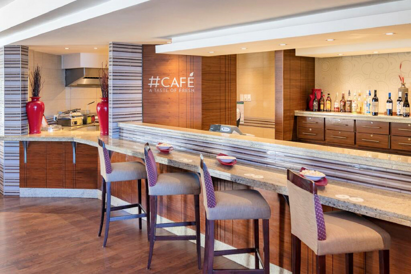 Cafe with bartop seating and open kitchen