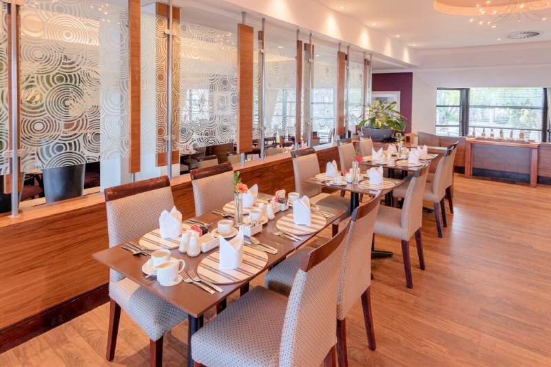Dining tables with table settings placed at an accessible height