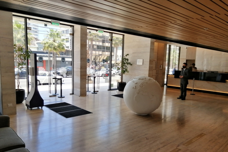 View of the lobby entrance from the inside with smooth stone floors.